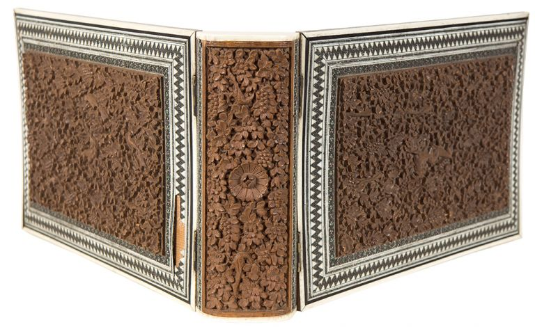 A wooden binding with inlaid carved wood panels and inlaid white metal bone and stained bone borders. 19th-century ANGLO-INDIAN School.