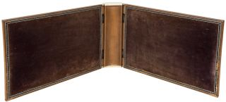 A wooden binding with inlaid carved wood panels and inlaid white metal bone and stained bone borders