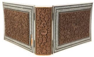 A wooden binding with inlaid carved wood panels and inlaid white metal bone and stained bone...
